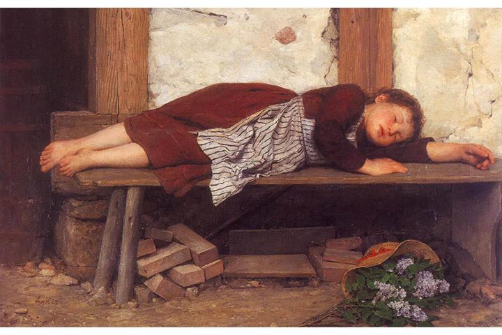 木のベンチで眠る少女